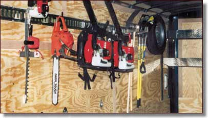 Hand tool rack, Typical landscape equipment on racking, Trailer shelving - Gano's Trailers And Trailer Accessories